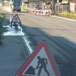Photograph of men at work signs