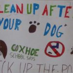Photograph of poster asking people to clean up after their dogs in Coxhoe by school child