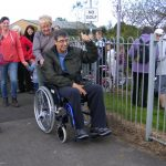 Photograph of man in a wheelchair sarting the walk