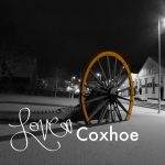 Photograph of pitwheel with the Love Coxhoe logo