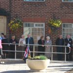 Photograph of people waiting at the Village Hall in 2010