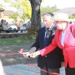Photograph of the ribbon being cut and falling