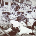 Photo of group of women with massive hats