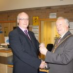 Photograph of formal handover from County Council chairman to Leisure Centre Chairman closer