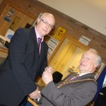 Photograph of formal handover from County Council chairman to Leisure Centre Chairman at angle