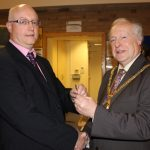 Photograph of formal handover from County Council chairman to Leisure Centre Chairman shaking hands