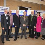 Photograph of Leisure centre Board with County Council Chairman posing