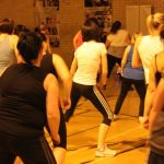 Photograph of Zumba participants bending knees