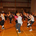 Photograph of Zumba participants moving fast