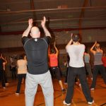 Photograph of Zumba participants clapping to the beat