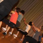 Photograph of Zumba participants squatting