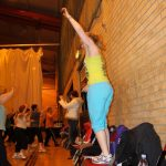 Photograph of Zumba participants with hands up instructor
