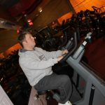 Photograph of man on training machine at active Life Centre at angle