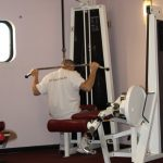 Photograph of man using weights at active Life Centre