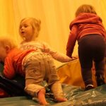 Photograph of children playing on soft play area