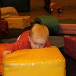 Photograph of children playing on soft play bricks