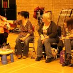 Photograph of mothers carers and toddlers enjoying play together