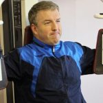 Photograph of man working hard using weights machine at active Life Centre