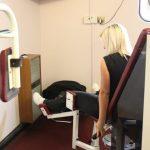 Lady on weights machine
