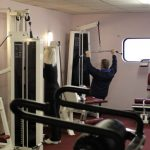 Photograph of man doing weights at active Life Centre
