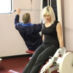 Photograph of lady at active Life Centre on one of the many weights machines