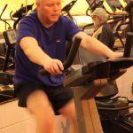 Photograph of man on bike from front at active Life Centre