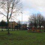 Photograph of outdoor playing areas and building from distance