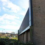 Photograph of main building close up and at an ang;le