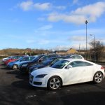 Photograph of cars in car park