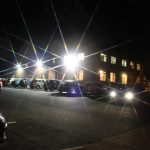 Photograph of village Hall at night with star filter effect