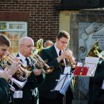 Photograph of band blowing their own trumpets