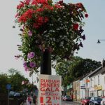 Photograph of hanging basket and sign advertising gala day
