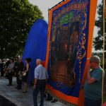 Photograph of banner at pit wheel unveiling event