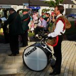Photograh of man with drum at unveiling event