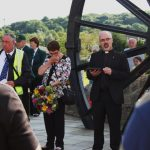 Photograph of vicar blessing the pit wheel at unveiling event