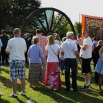 Photograph of people on village green at unveiling event