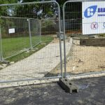 Photograph of hard landscaping in progress with safety fencing