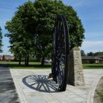 Photograph of pit wheel taken from the side with shadow