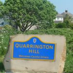 Photo of stone village entrance sign