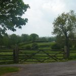 Photo of gate and field at south end of village