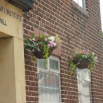 Photograph of hanging basket outside Village hall