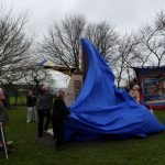 Photograph of unveiling of sculpture in sequence nearly off