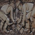 Photograph of miners extracting coalpart of sculpture