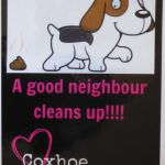 Photograph of poster saying a good neighbour cleans up