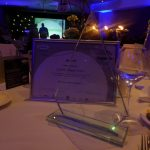 Photograph of actual glass award with brochure