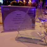 Photograph of actual glass award with awcetificate