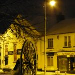 Photograph of pitwheel with front street in the snow
