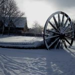 Photograph of pit wheel in shadow in the snow