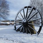 Photograph of pit wheel in the snow with slight bshadow as its not all that sunny
