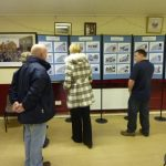 Photograph of people looking at exhibition for Parish Plan